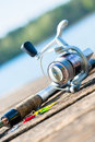 Fishing rod on close to lake Royalty Free Stock Photo