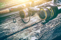 fishing rod gear background spinning wheel reel angler bait concept Royalty Free Stock Photo