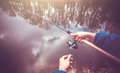 Fishing rod in hands of a fisherman Royalty Free Stock Photo