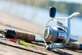 Fishing rod on jetty close Royalty Free Stock Photo