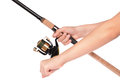 Fishing rod, reel in hands Royalty Free Stock Photography