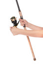Fishing rod, reel in hands Stock Image