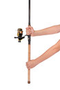 Fishing rod, reel in hands Royalty Free Stock Photo