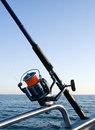 Fishing rod reel at sea. Stock Photo