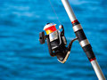 Fishing rod with a spinning reel Royalty Free Stock Photo