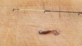 Fishing rod on wood background Stock Photography