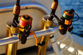 Fishing rods on offshore trip poles a boat headed for charter Royalty Free Stock Image
