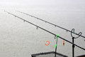 Fishing rods in rainy weather Royalty Free Stock Photo