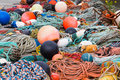 Fishing ropes and equipment during the day on the floor Stock Images