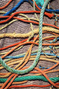 Fishing ropes and net messy background of colorful old nets under sunlight Royalty Free Stock Image
