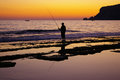 Fishing sea sunset horizon Stock Photography