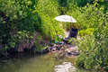 Fishing spot and gear in green landscape Royalty Free Stock Photo