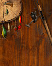 Fishing tackle background wooden with and knife Royalty Free Stock Photos
