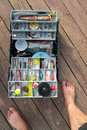 Fishing tackle box on a dock large fishermans fully stocked with lures and gear for Royalty Free Stock Images