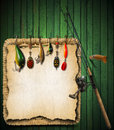 Fishing tackle green wood background wooden with knife and wicker basket Royalty Free Stock Photo