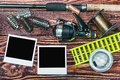 Fishing tackle and photoframe on wooden table Royalty Free Stock Photography