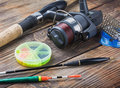 Fishing tackle on a wooden table Royalty Free Stock Images