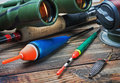 Fishing tackle on a wooden table focus the float Royalty Free Stock Photo
