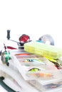 Fishing tackles and lure in storage boxes baits transparent plastic on bright white background for design advertising or Stock Photo