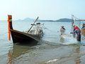 Fishing trang thailand – march fishermen are collecting fishes from the floating seine at the beach on march in trang southern Royalty Free Stock Images