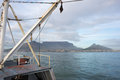 Fishing trawler entering table bay a view of mountain and cape town from the deck of a in Royalty Free Stock Image