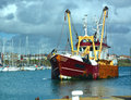 Fishing trawler leaving shoreham port in the uk the vertrouwen was built in and is of steel construction Stock Image