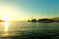 Fishing trawler and a sailboat moored in the harbor of a small town Postira - Croatia, island Brac Royalty Free Stock Photo
