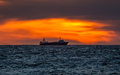 Fishing trawler in sunset factory stern at Royalty Free Stock Image