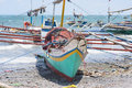 Fishing vessels in the philippines beached with outriggers at general santos city southernmost city of Stock Photo