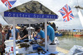 Fishmongers prepare and shuck oysters for visitors at the Whitstable Oyster Festival Royalty Free Stock Photo