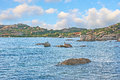 The fisshing village la maddalena sardinia september birds relax on stones with fishing nido d aquila in a small haven on Royalty Free Stock Image