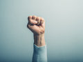 Fist in the air a clenched male is up Stock Photo
