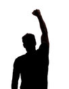 Fist in the air silhouette isolated over white background Royalty Free Stock Photos