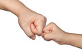 Fist bump with a kid closeup of between an adult and child isolated on white background Royalty Free Stock Photography