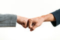 Fist bump two businessmen bumping against a white background Royalty Free Stock Image