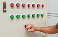 Fist smash touch on red emergency stop switch and reset with gre Royalty Free Stock Photo