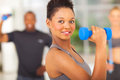 Fit african woman beautiful lifting dumbbell Royalty Free Stock Photo
