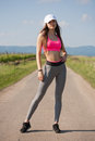 Fit and agile young brunette woman running outdoors in the sunshine Stock Photos