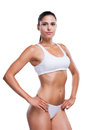 Fit beauty attractive young woman in white bra and panties holding hands on hip while standing isolated on white Stock Photos