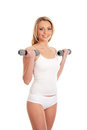 A fit blond woman training in white clothes Stock Photo