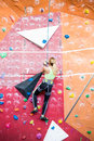 Fit blonde rock climbing indoors Royalty Free Stock Photo