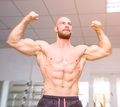 Fit bodybuilder celebrating succes Royalty Free Stock Photo