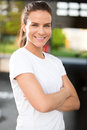 Fit and confident woman at fitness gym young attractive happy a center people workout in the background Stock Images