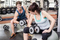 Fit couple lifting dumbbells at crossfit gym Stock Photography