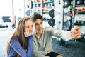 stock image of  Fit couple in modern crossfit gym with smartphone.