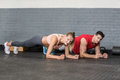 Fit couple planking together in gym Royalty Free Stock Photo