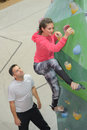 Fit couple rock climbing indoors at climbing wall Royalty Free Stock Photo