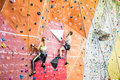 Fit couple rock climbing indoors at the gym Royalty Free Stock Photography