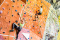 Fit couple rock climbing indoors Royalty Free Stock Photo