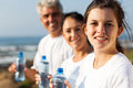 Fit family water with bottle after exercise in the morning Stock Images
